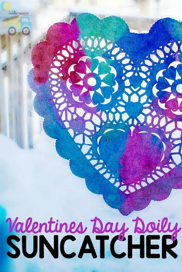 These Valentines Day Doily Suncatchers are beautiful and so fun to make! It's a perfect simple kids activity for Valentines Day!