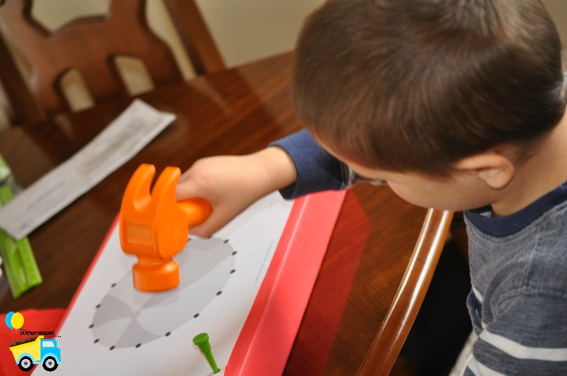 This fun pounding fine motor activity for kids is perfect for active boys to develop their fine motor skills! Click through to give it a try!
