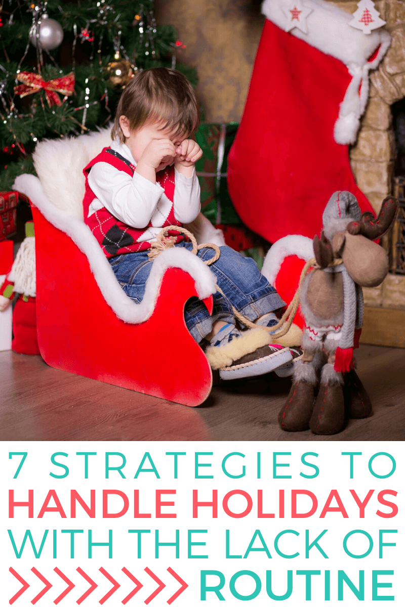 Boy sits in a sleigh inside of a room that's decorated with Christmas decorations like a Christmas tree, reindeer, and stocking. The boy is upset, and has his hands in front of his face, crying. Text reads: 7 Strategies to Handle Holidays With the Lack of Routine