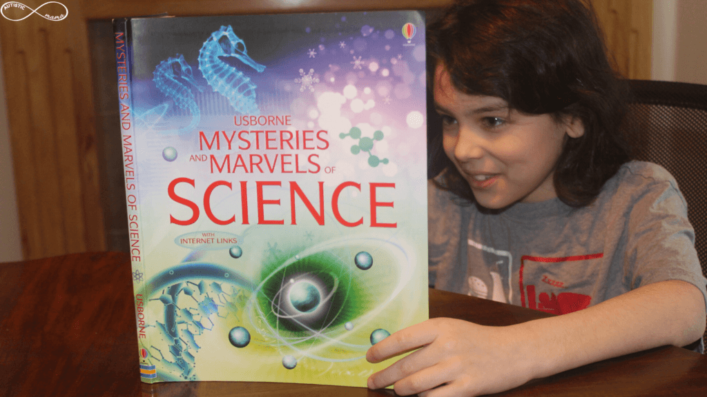 Mr. C holding and reading a book titled Usborne Mysteries and Marvels of Science.