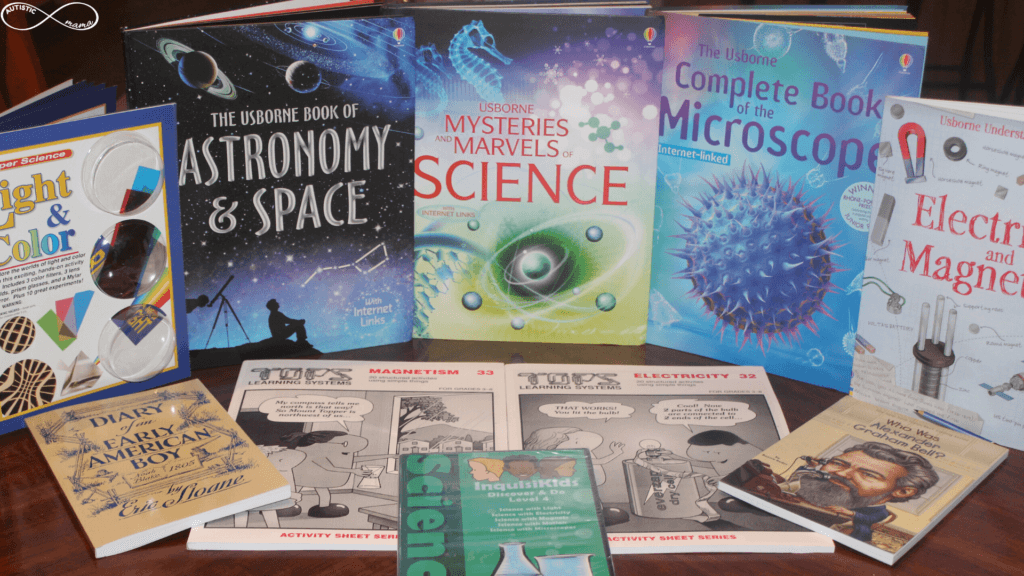 Books arranged on a table including: Light & Color, The Usborne Book of Astronomy & Space, Mysteries and Marvels of Science, The Usborne Complete Book of the Microscope, Science With Simple Things Electricty 32, Science With Simple Things Magnetism 33, Electricity and Magnetism, Diary of an Early American Boy, Who Was Alexander Graham Bell, and the DVD Inquisikids Discover & Do Level 4
