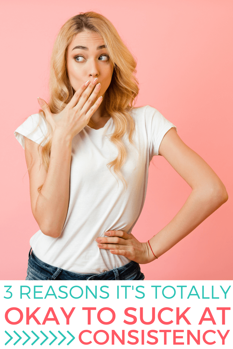"""Woman stands in front of pink background with her hand over her mouth looking sideways as if to say """"oops"""". Text reads: """"3 Reasons It's Totally Okay to Suck At Consistency"""""""